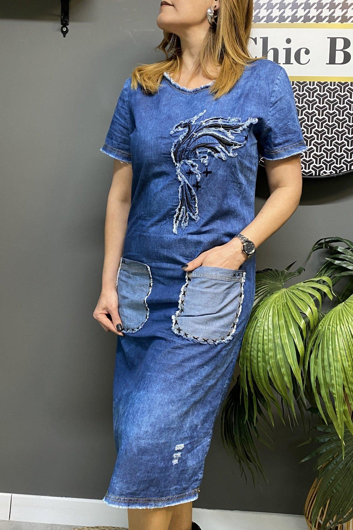 https://resim.chicbag.com.tr/p000599/mvi/onu-kus-desenli-cift-cepli-sokuk-yaka-detayli-kisa-kollu-elbise-dvs-01b03df7188a.