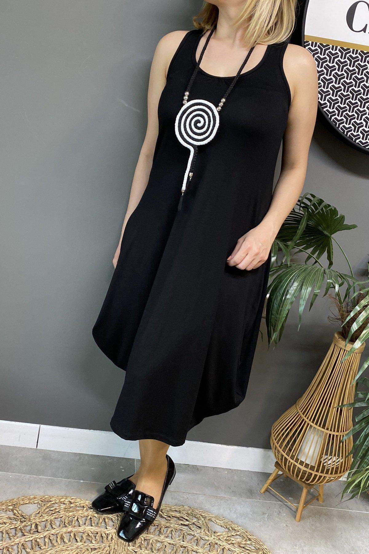 https://resim.chicbag.com.tr/p000702/shy/sirti-fileli-kolsuz-yanlari-ucgen-elbise-crr-01b03df7188a.